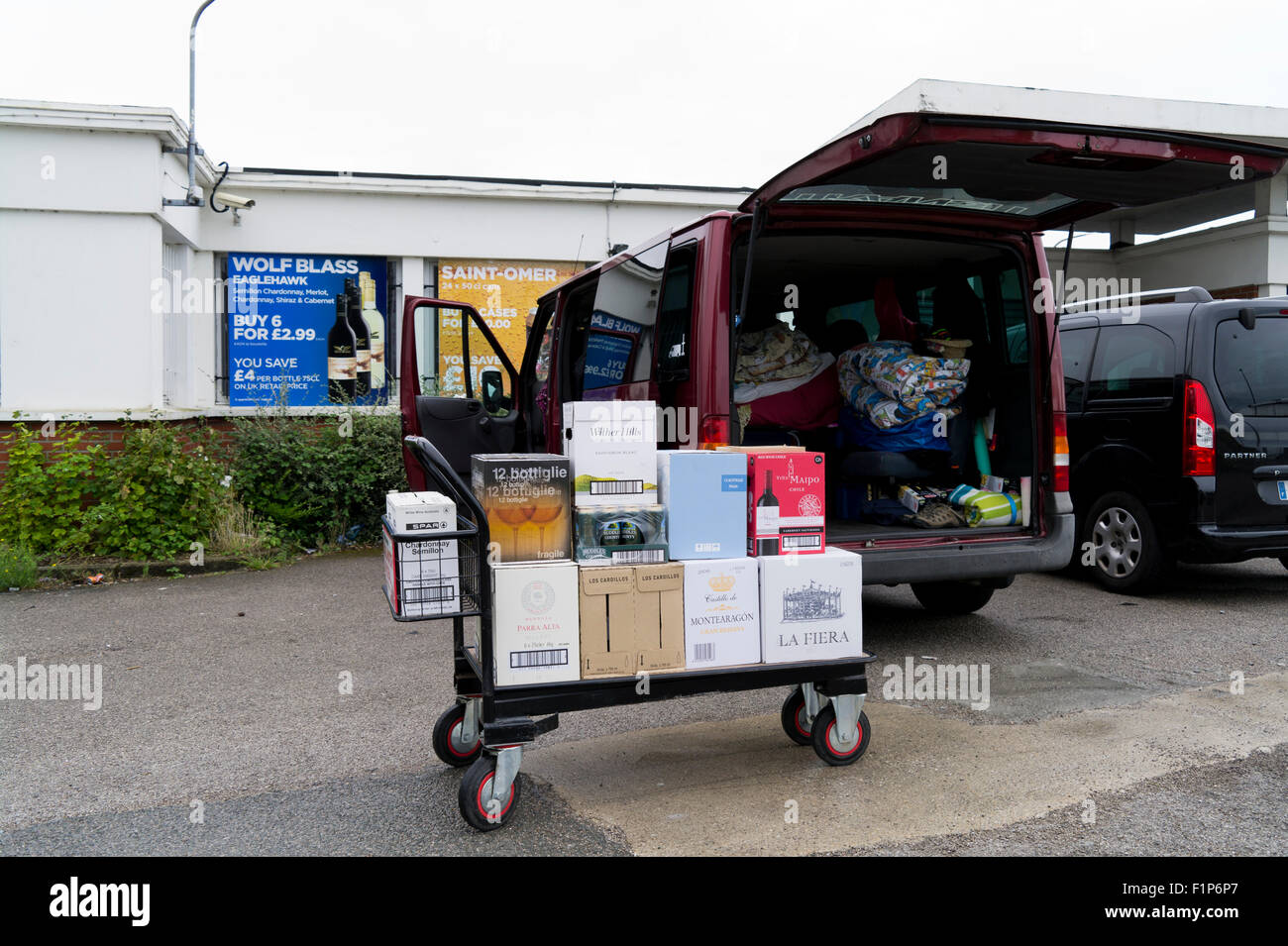 Booze cruise buying cheap alcohol at a Calais wine superstore France - Stock Image