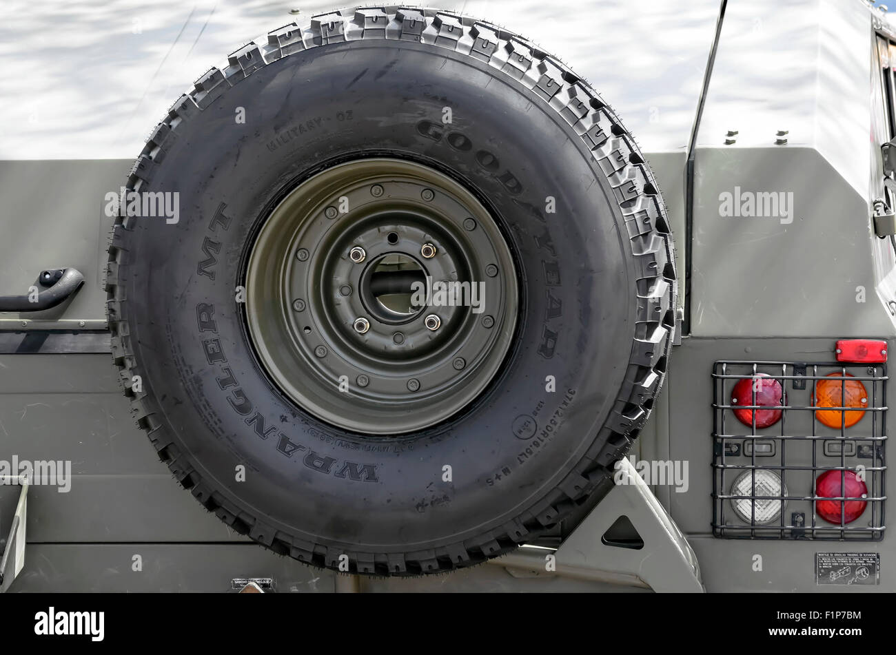 Spare tire of URO VAMTAC, -High Mobility Tactical Vehicle- of spanish army, during a show, in Alcala de Henares. - Stock Image