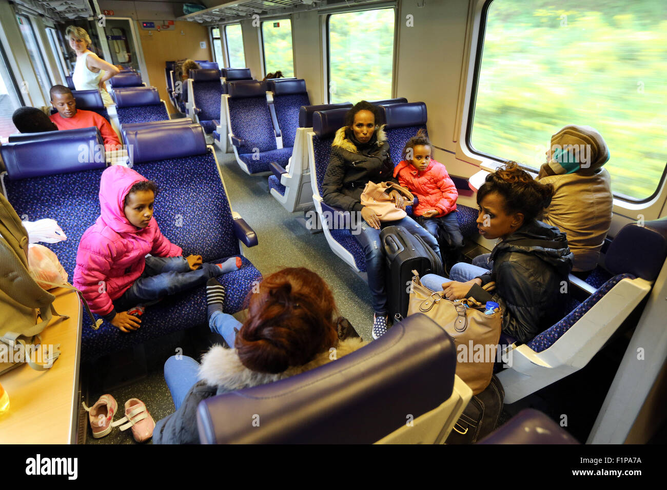 Travel By Train Italy Migrants from eritrea traveling in a eurocity train from verona migrants from eritrea traveling in a eurocity train from veronaitaly to munich germany on september 2 2015 thousands of migrants are traveling to germany sisterspd