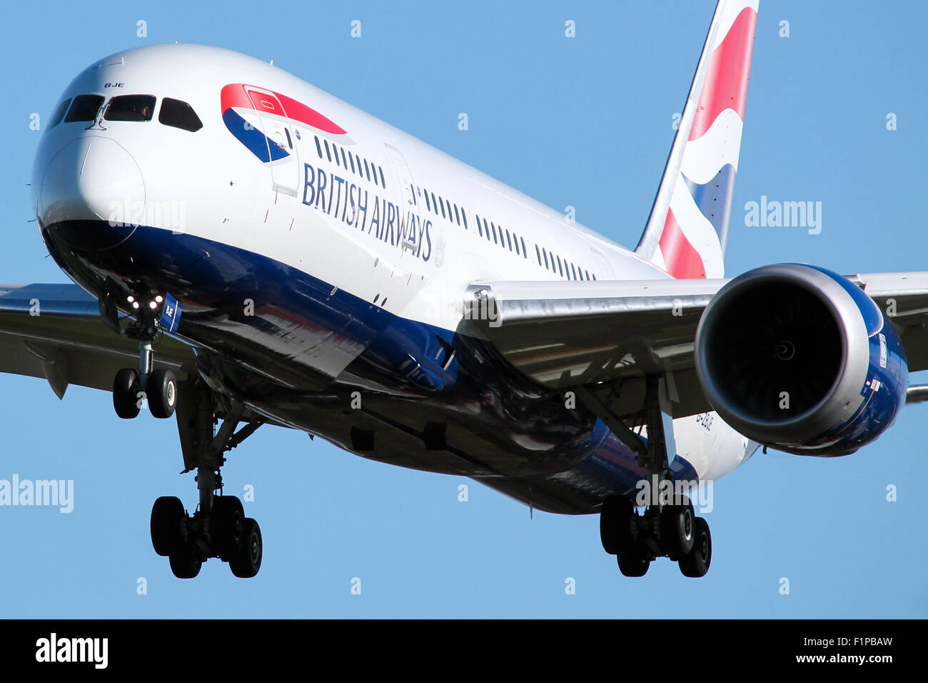 British Airways Boeing 787-8 approaches runway 27L at London Heathrow airport. - Stock Image