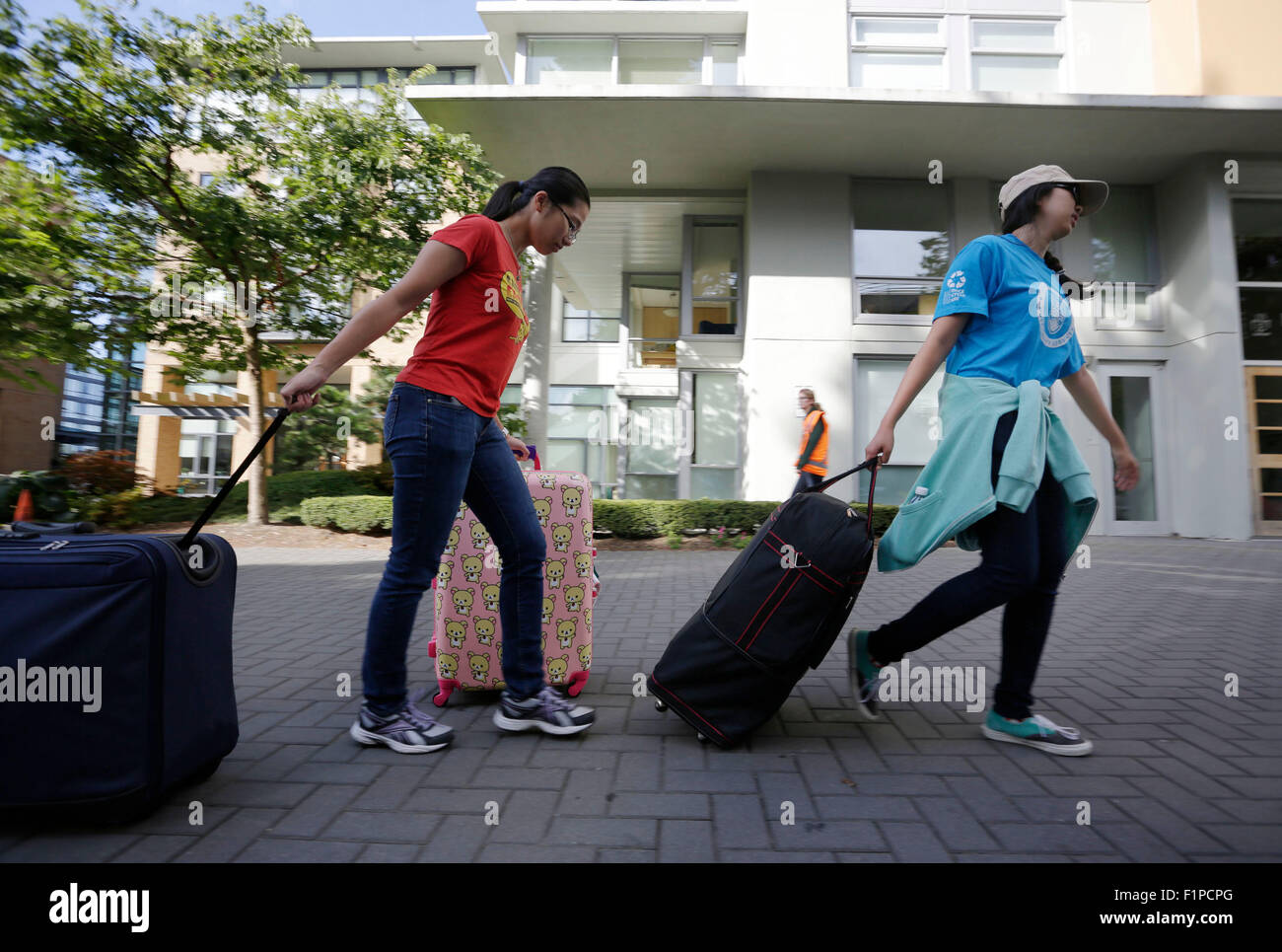 Vancouver, Canada. 5th Sep, 2015. University students transport luggages into campus residence at UBC in Vancouver, - Stock Image
