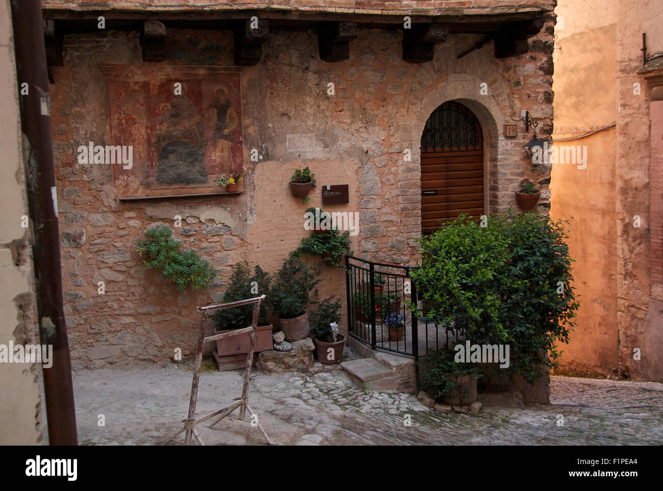 Casa Medievale, Trevi, at sunset in Spring - Stock Image