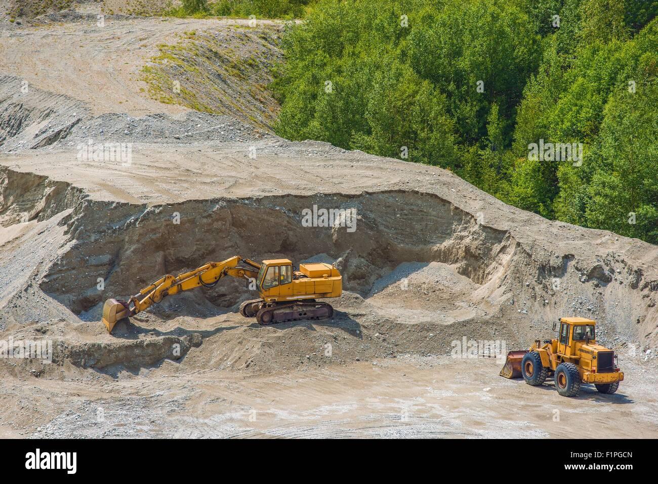 Excavation Ground Works. Excavator and Large Bulldozer Works. - Stock Image