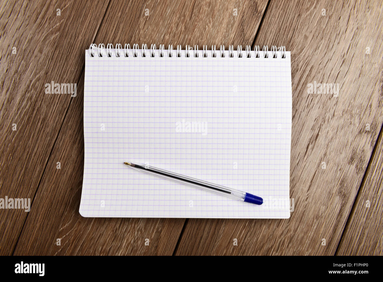 Notebook and pen. Blank white page over wooden  background - Stock Image
