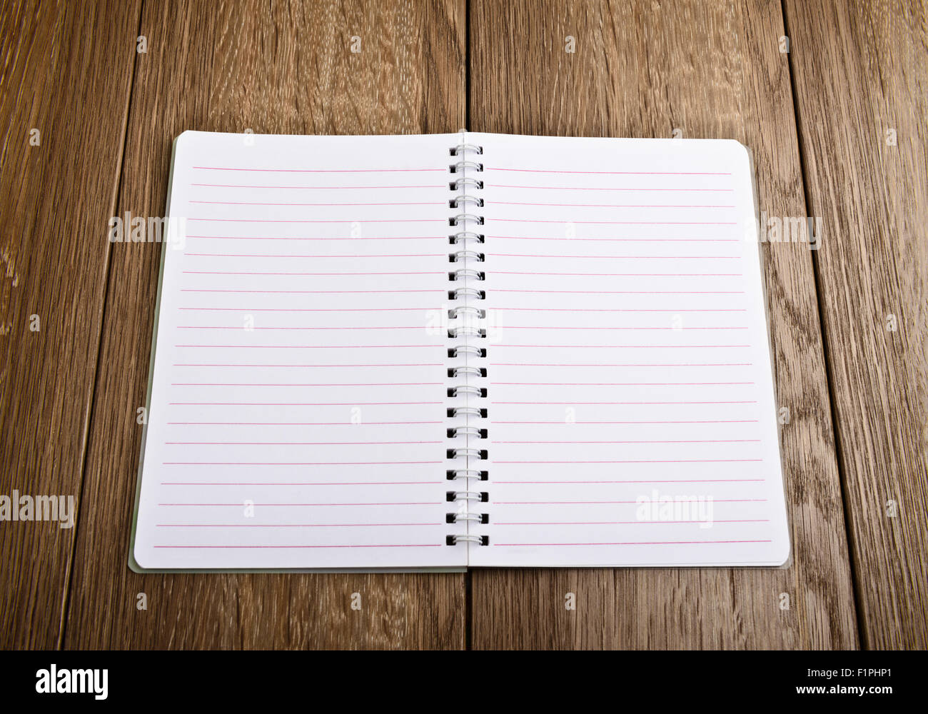 Notebook paper. Blank white page over wooden  background - Stock Image