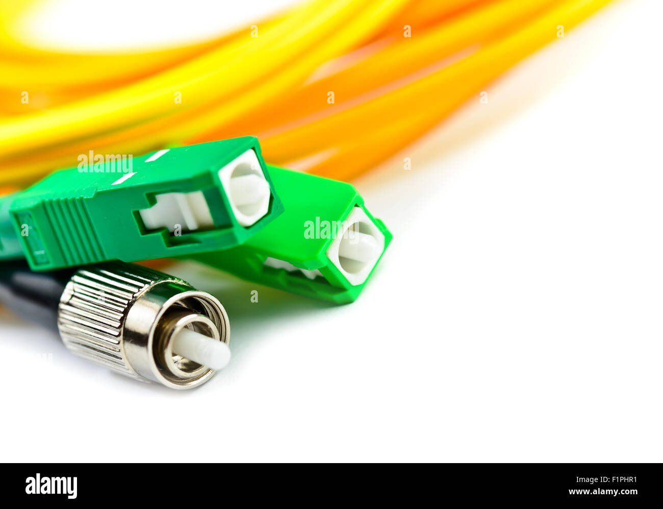 Fiber optic cable link plug connector isolated on white - Stock Image