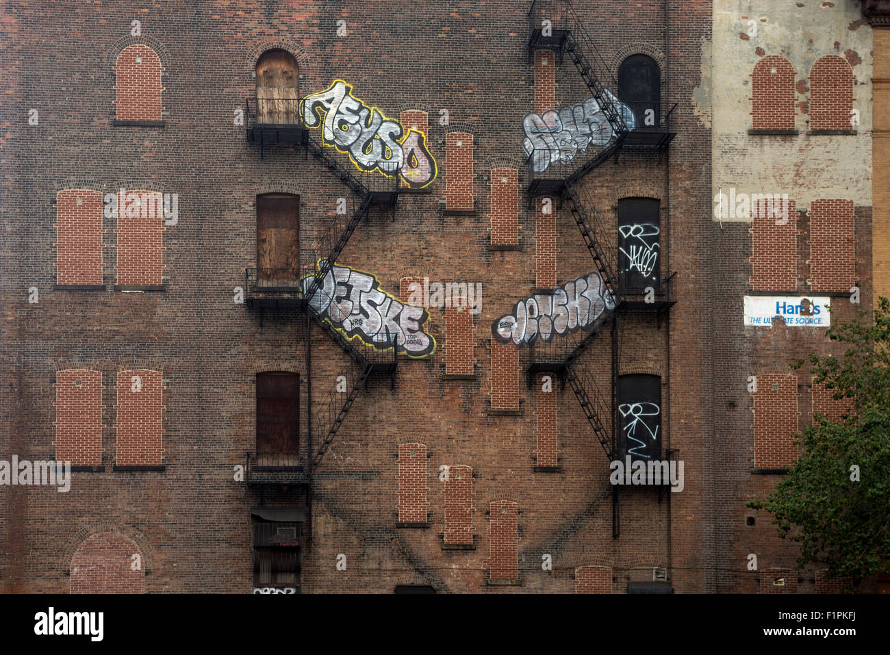 New York, NY 30 August 2015 - Vacant tenement building with graffiti and fire escapes on the Lower East Side - Stock Image