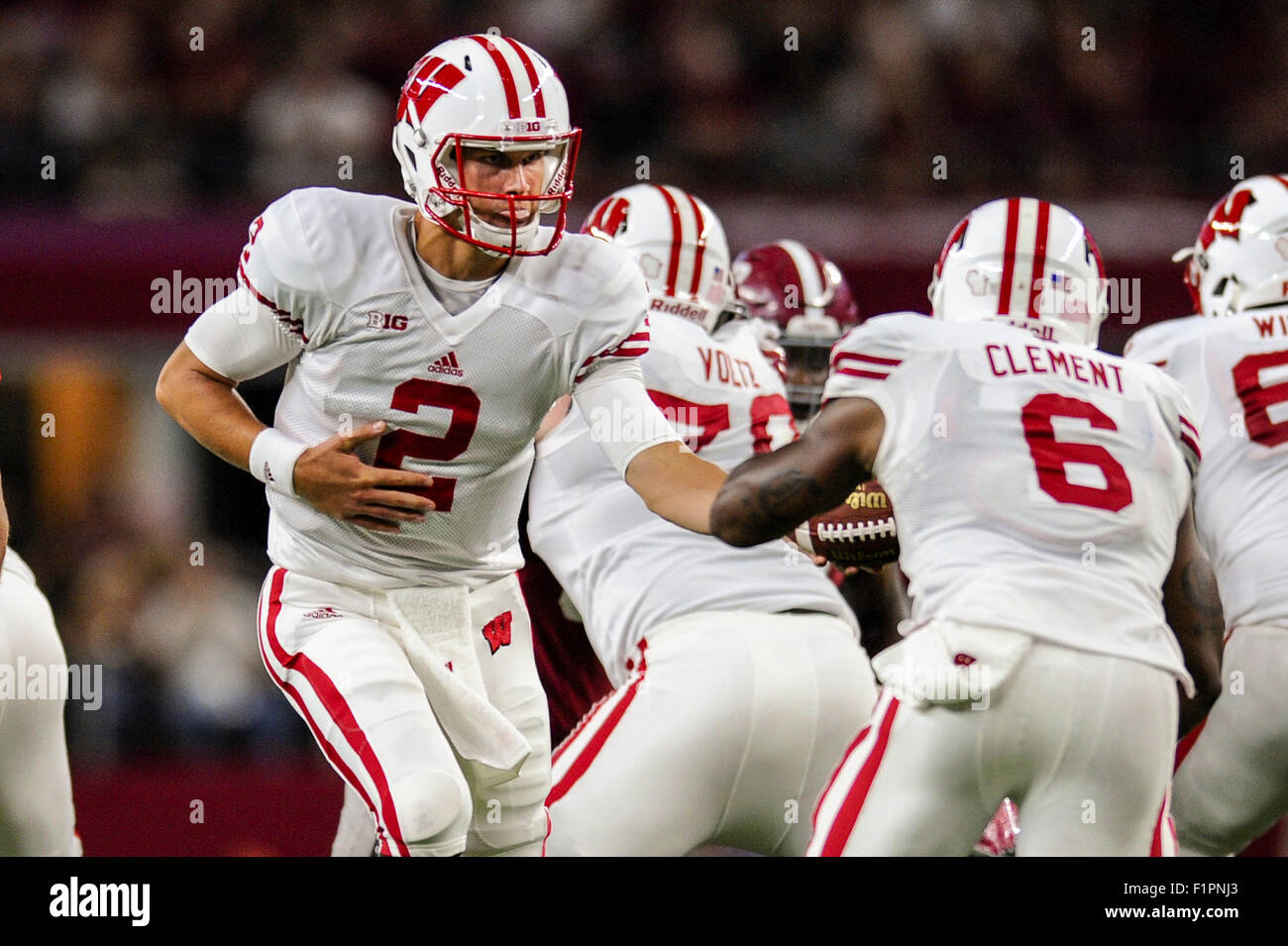 Wisconsin quarterback Joel Stave (2) turns to hand the ball to running back Corey Clement (6) during an NCAA football - Stock Image