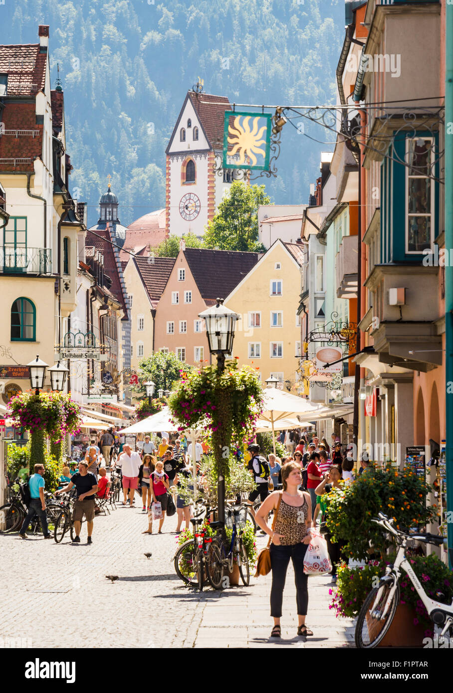 Tourists in the pedestrian area of Fuessen. - Stock Image