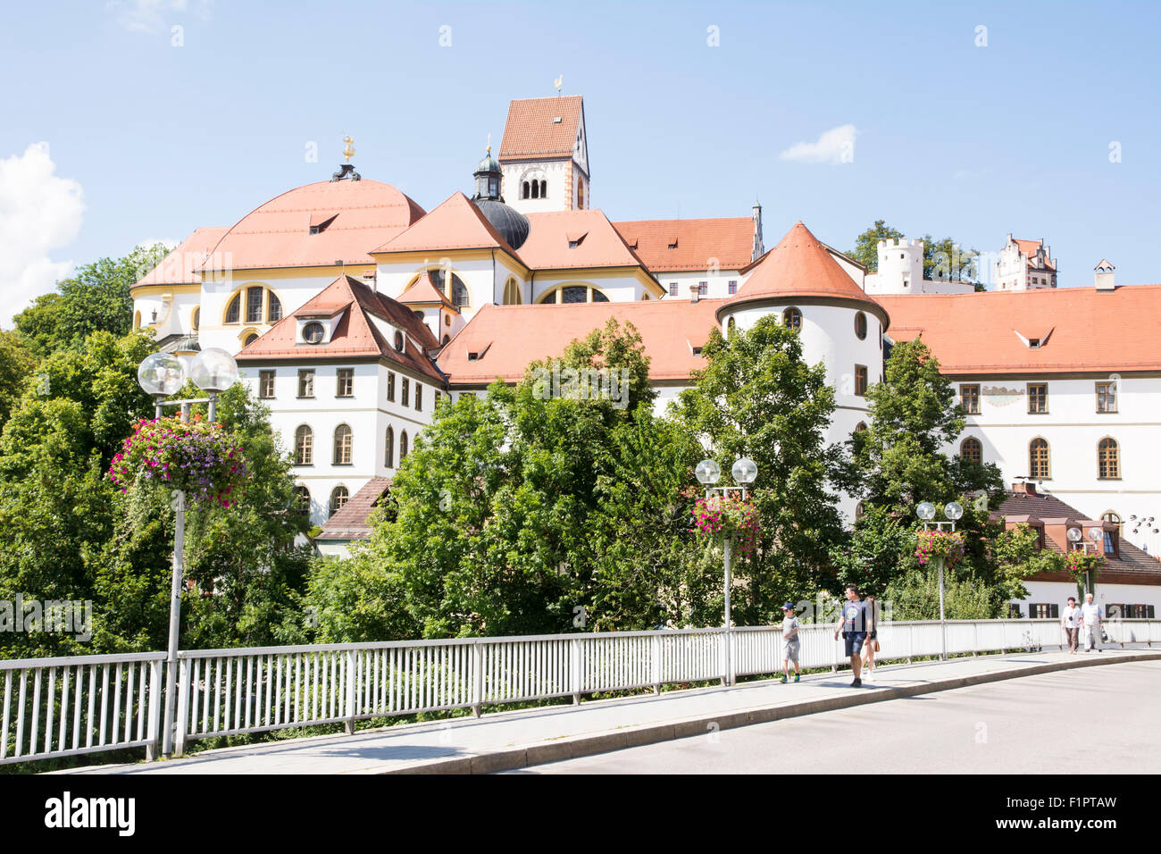 FUESSEN, GERMANY - AUGUST 22: Tourists at the Kloster Sankt Mang in Fuessen, Germany on August 22, 2015. The abbey - Stock Image