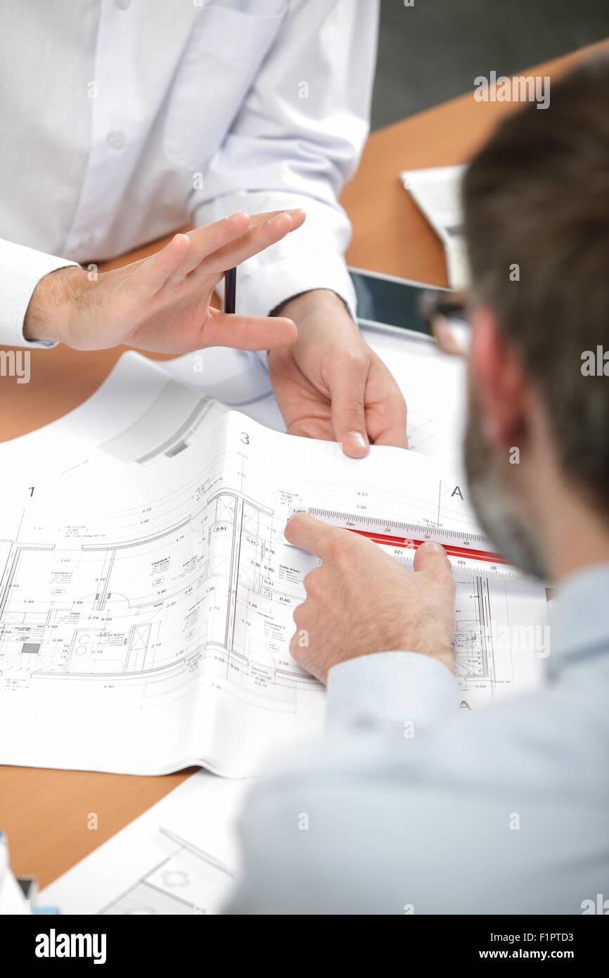 Architects working hard - Stock Image