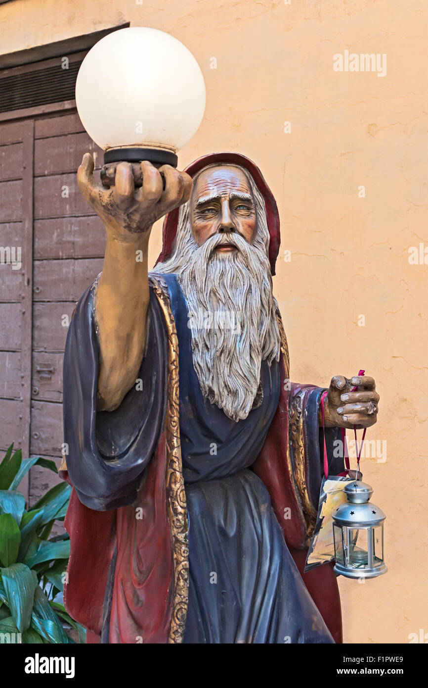 Sculpture of Magician Merlin with crystal ball Stock Photo ...