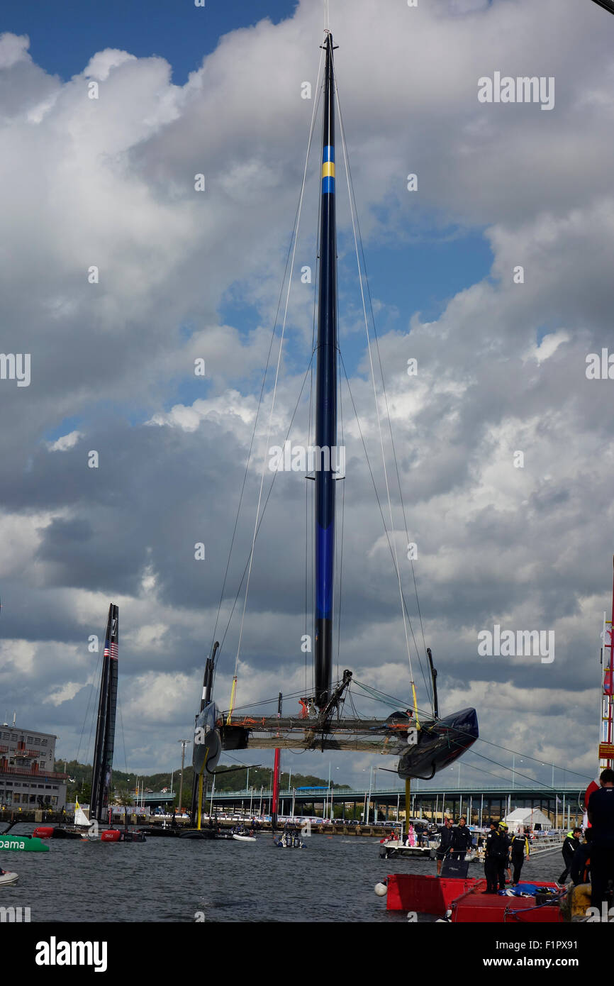 Swedish America's Cup  72 class catamaran is lifted for wing sail repair. 2015-08-29 Gothenburg, Sweden. - Stock Image