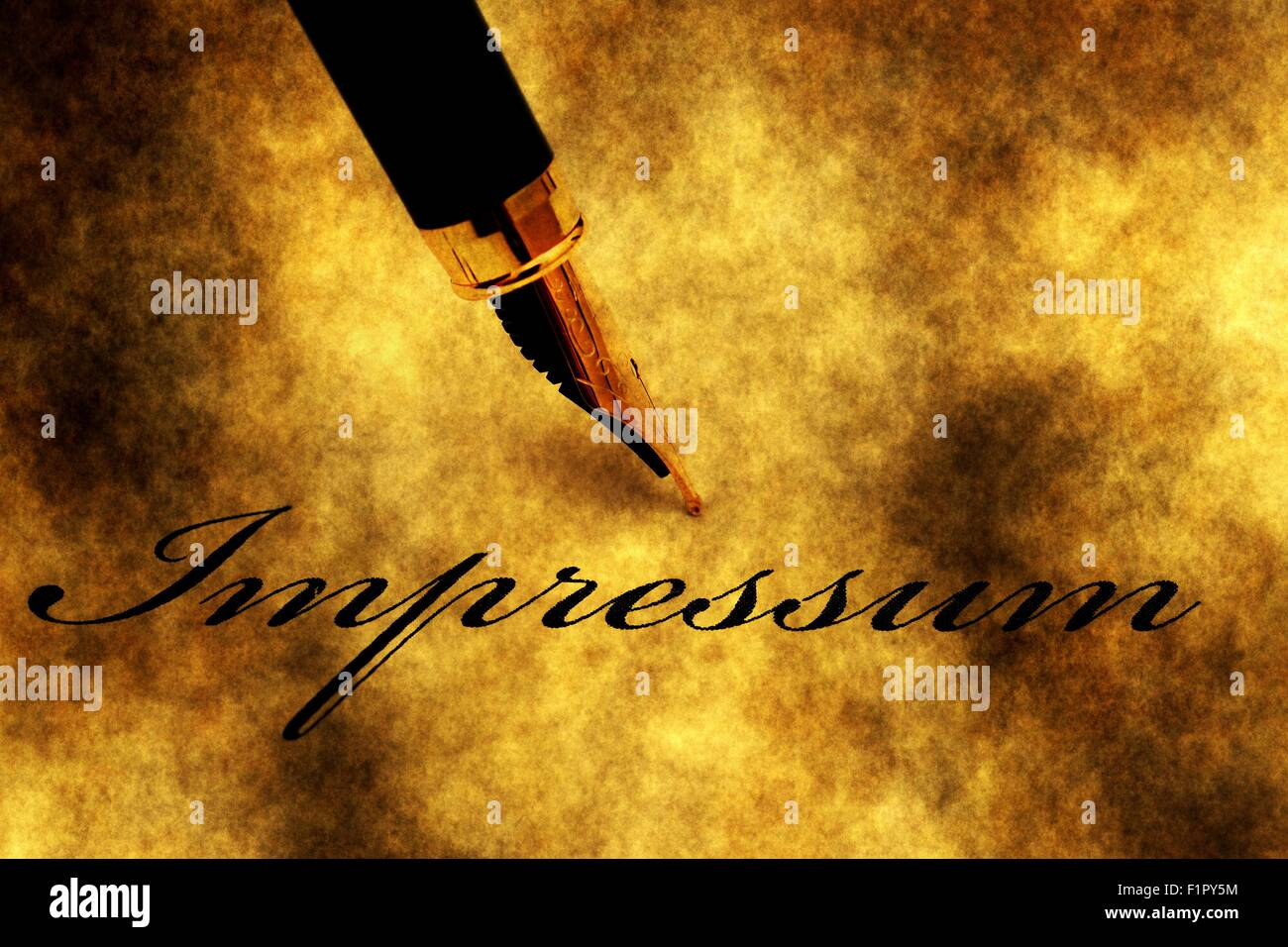 Impressum text and fountain pen - Stock Image