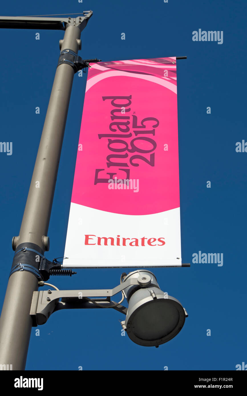 hanging banner advertising the 2015 rugby world cup, and sponsors emirates, in twickenham, england - Stock Image