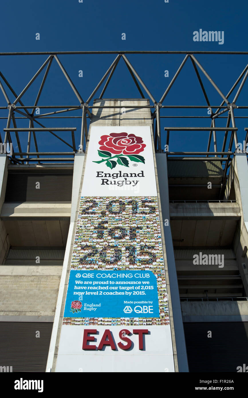 wall sign at twickenham stadium marking the creation of 2,015 rugby coaches by the commencement of the 2015 rugby - Stock Image