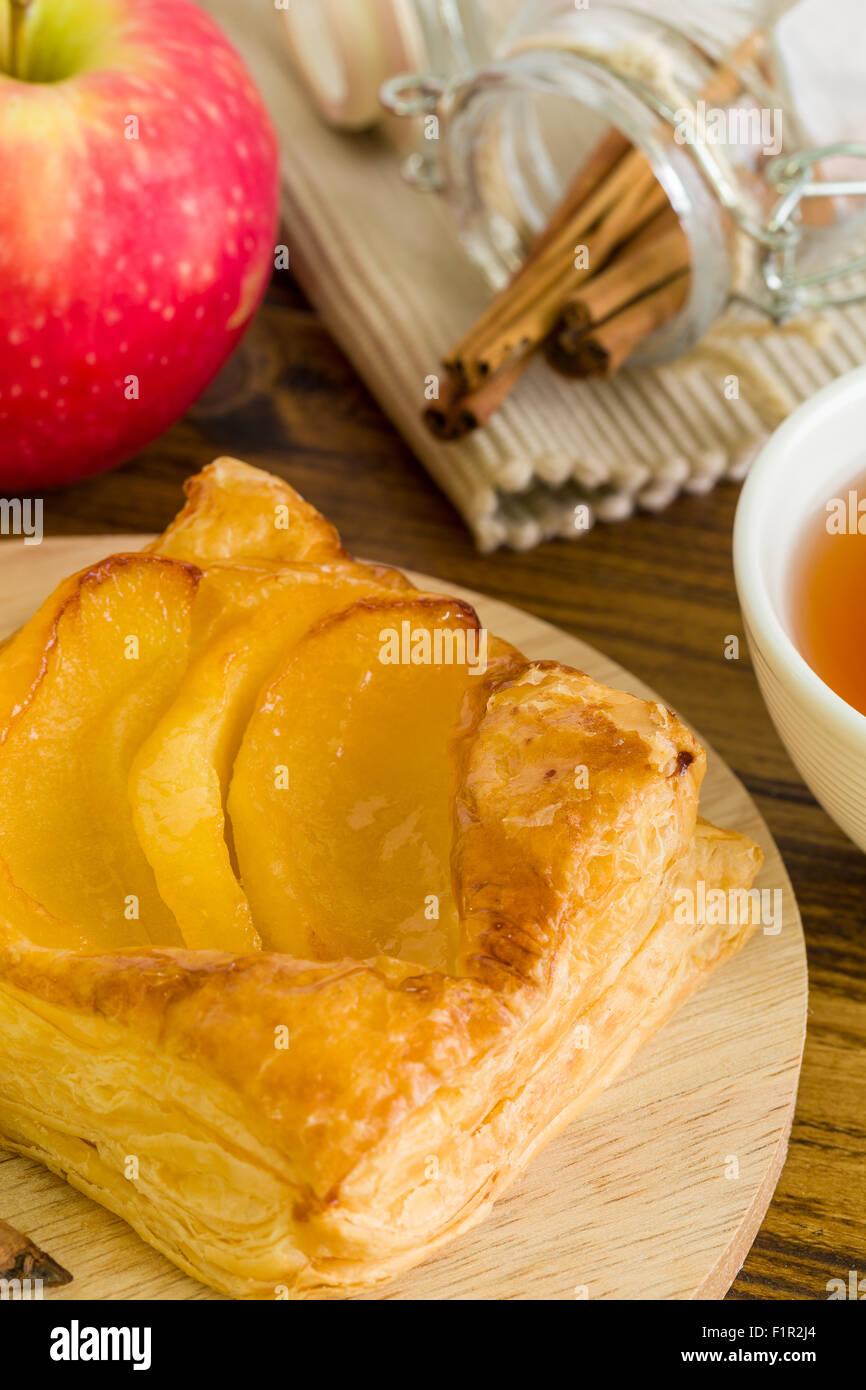 Apple turnover puff pastry for tea break. - Stock Image