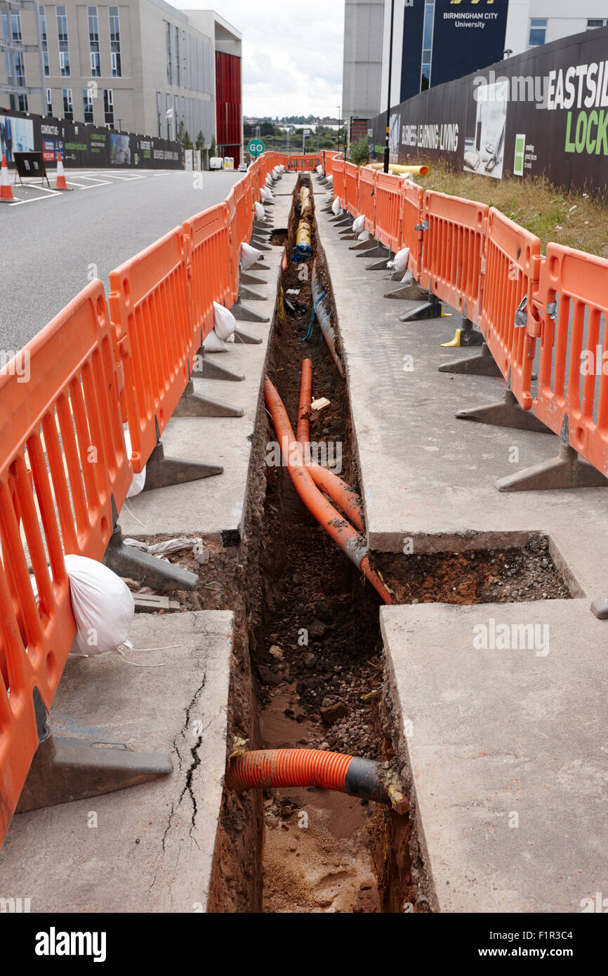 new services trench dug to lay gas and fibre optic infrastructure Birmingham UK - Stock Image