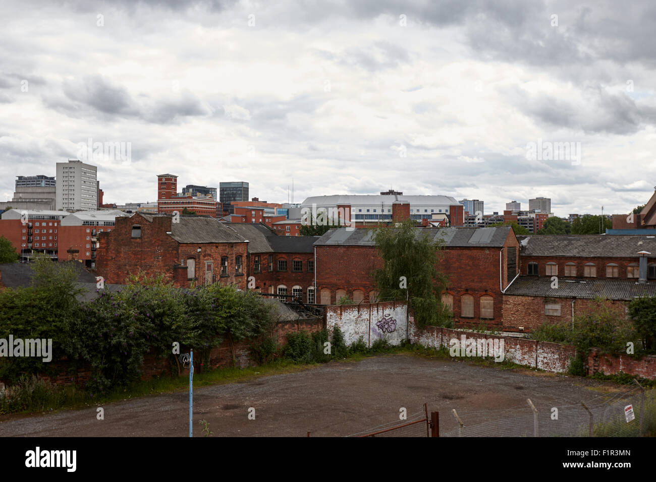 view of Birmingham city centre across various brown field and derelict old buildings UK - Stock Image