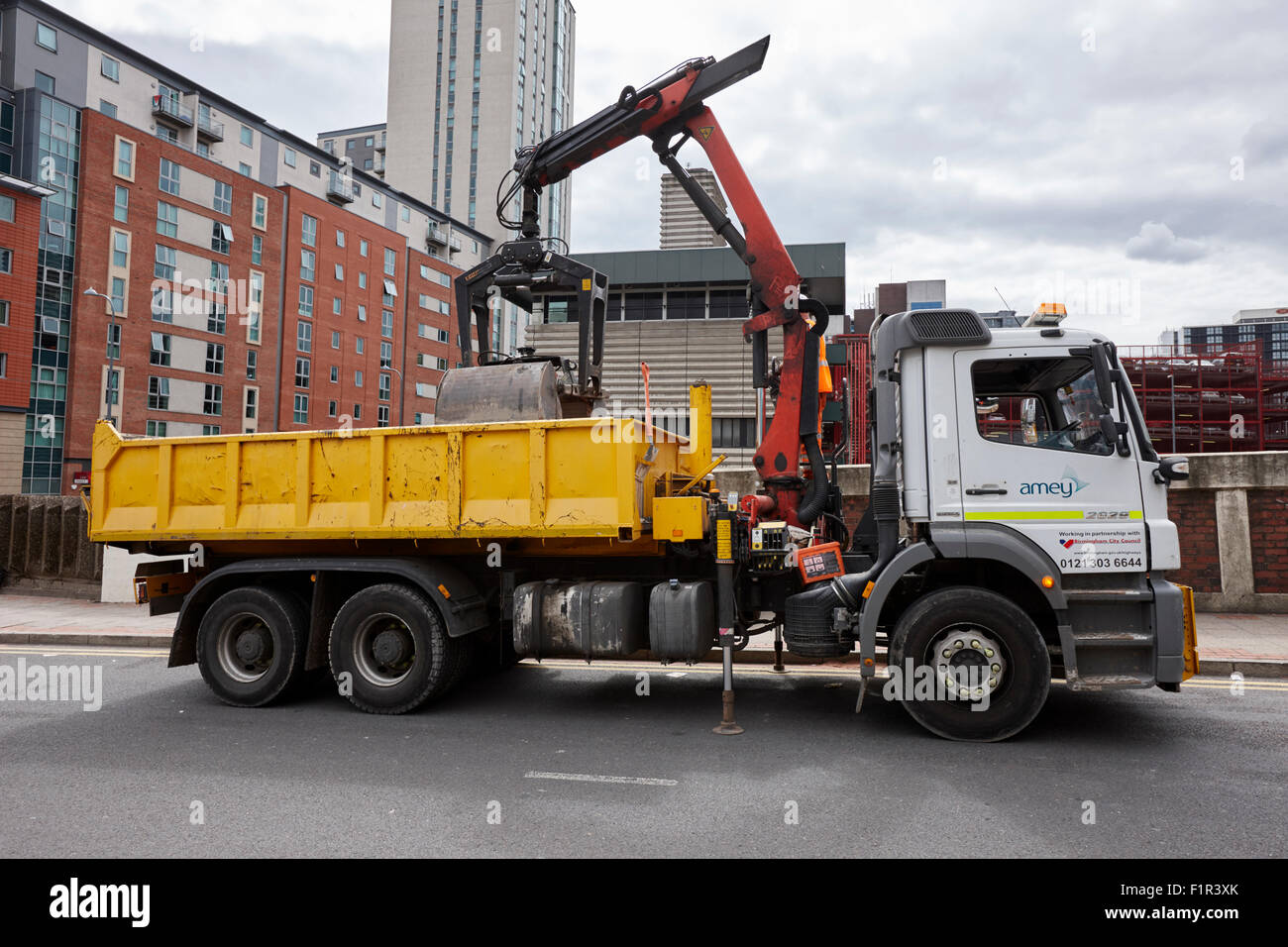 lorry unloading building materials at the roadside in city centre Birmingham UK - Stock Image