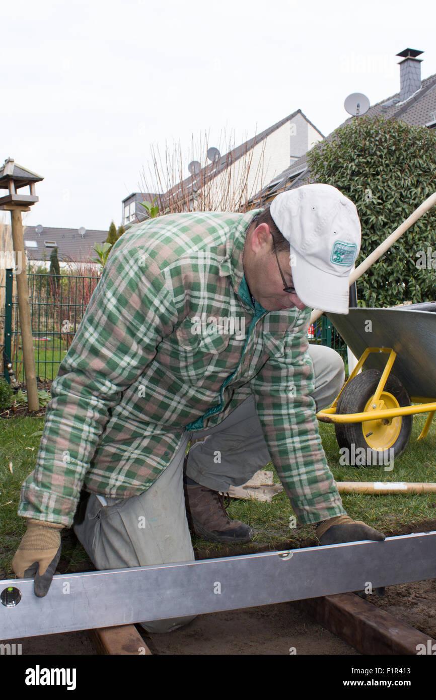 Gartenbau, Terrassenbau, Holzbolen, Holzdielen, Heimwerker, Landschaftsbau, Stock Photo