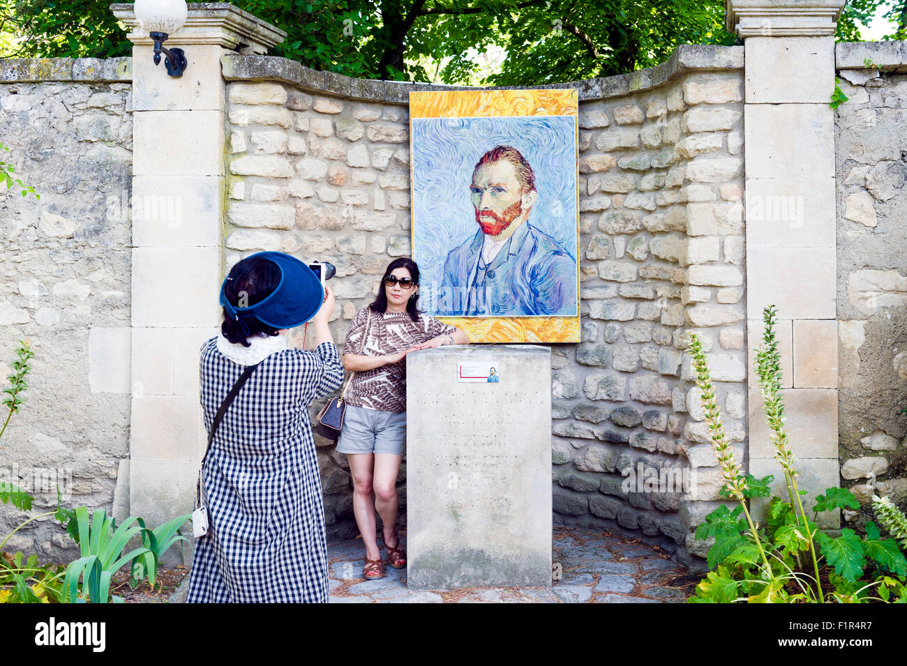 Europe. France. Bouches-du Rhone Saint-Remy-de-Provence. Chinese Tourists photographing themselves in front of a - Stock Image