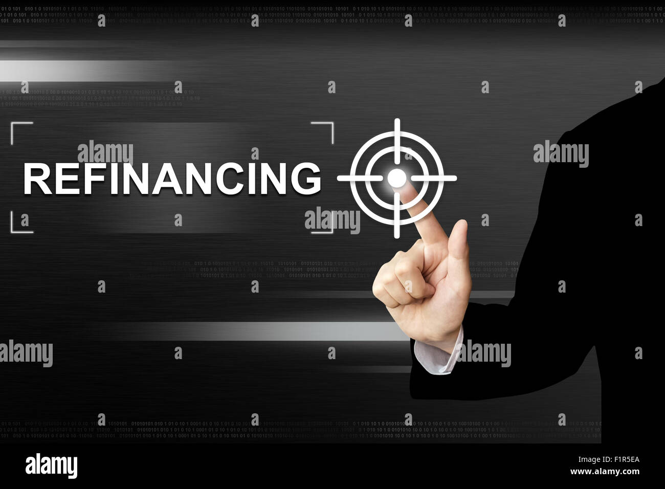 business hand clicking refinancing button on a touch screen interface - Stock Image