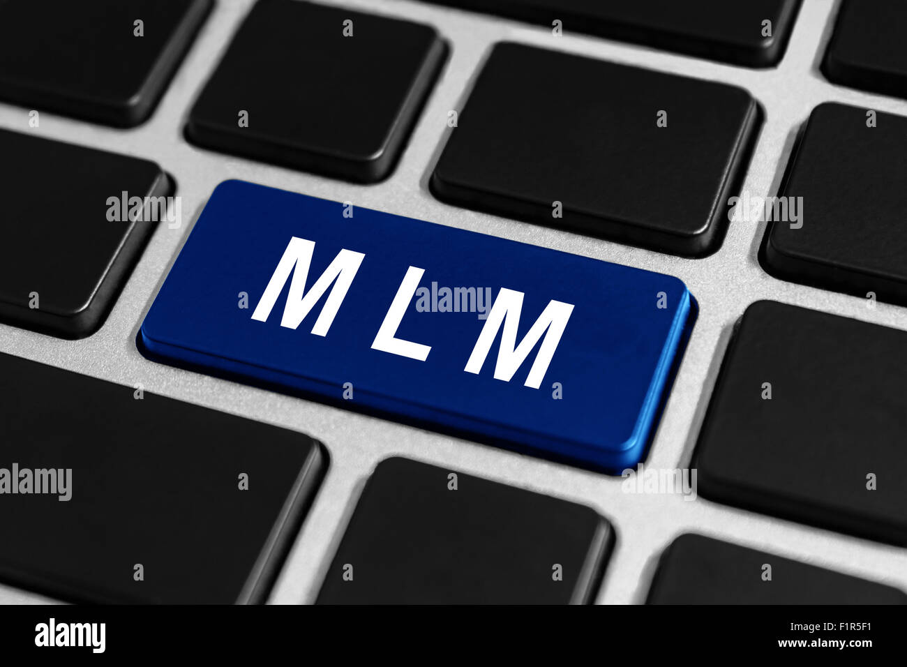 MLM or Multi Level Marketing blue button on keyboard, business concept Stock Photo