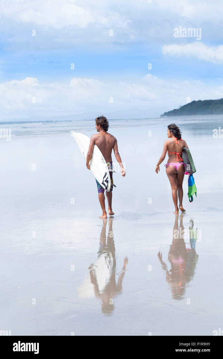 Surfers on the beach in Santa Teresa - Stock Image
