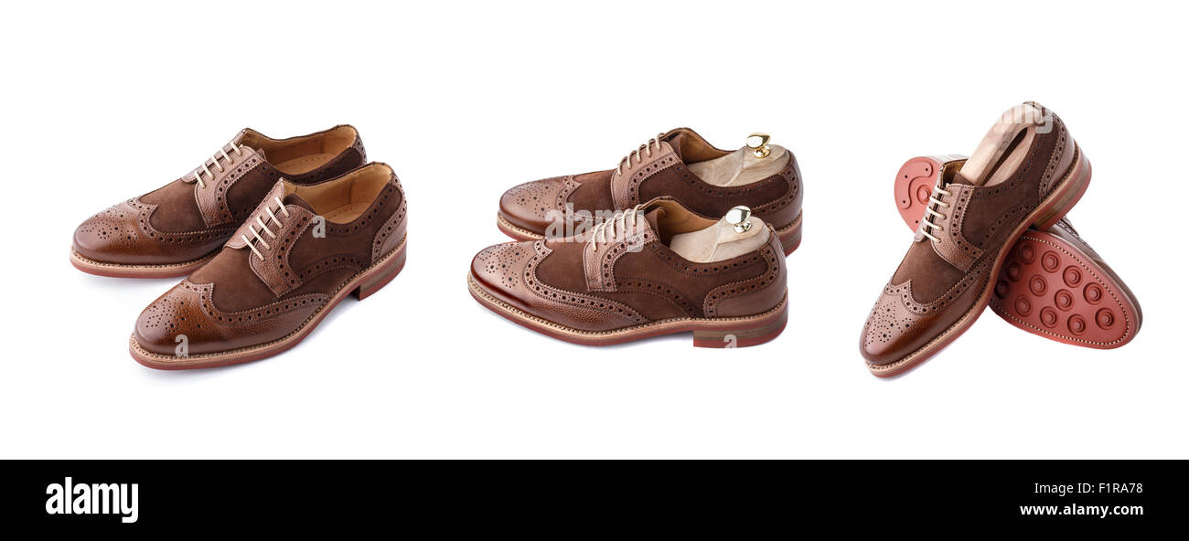 Set of two tone brown suede brogues (also known as derbies,gibsons or wingtips) on thick welted red rubber sole. Stock Photo