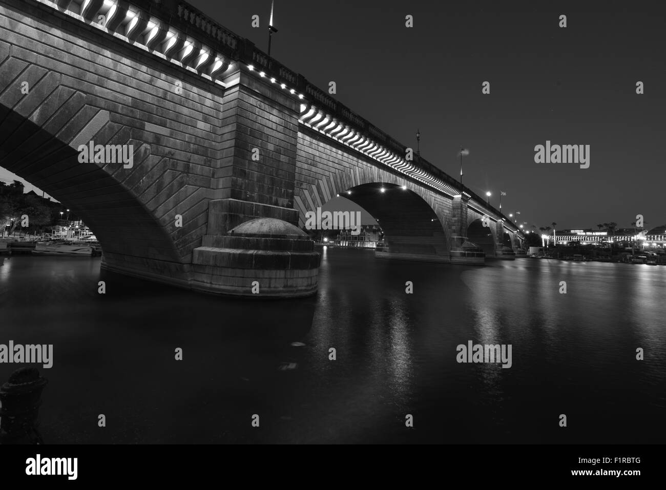 London Bridge at Lake Havasu at on a late summers night in Sept. - Stock Image