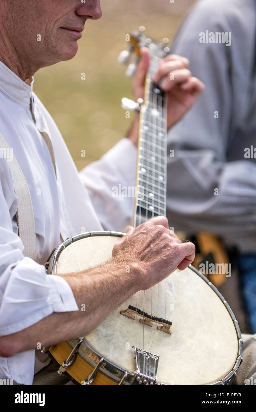 A man playing a banjo, - Stock Image