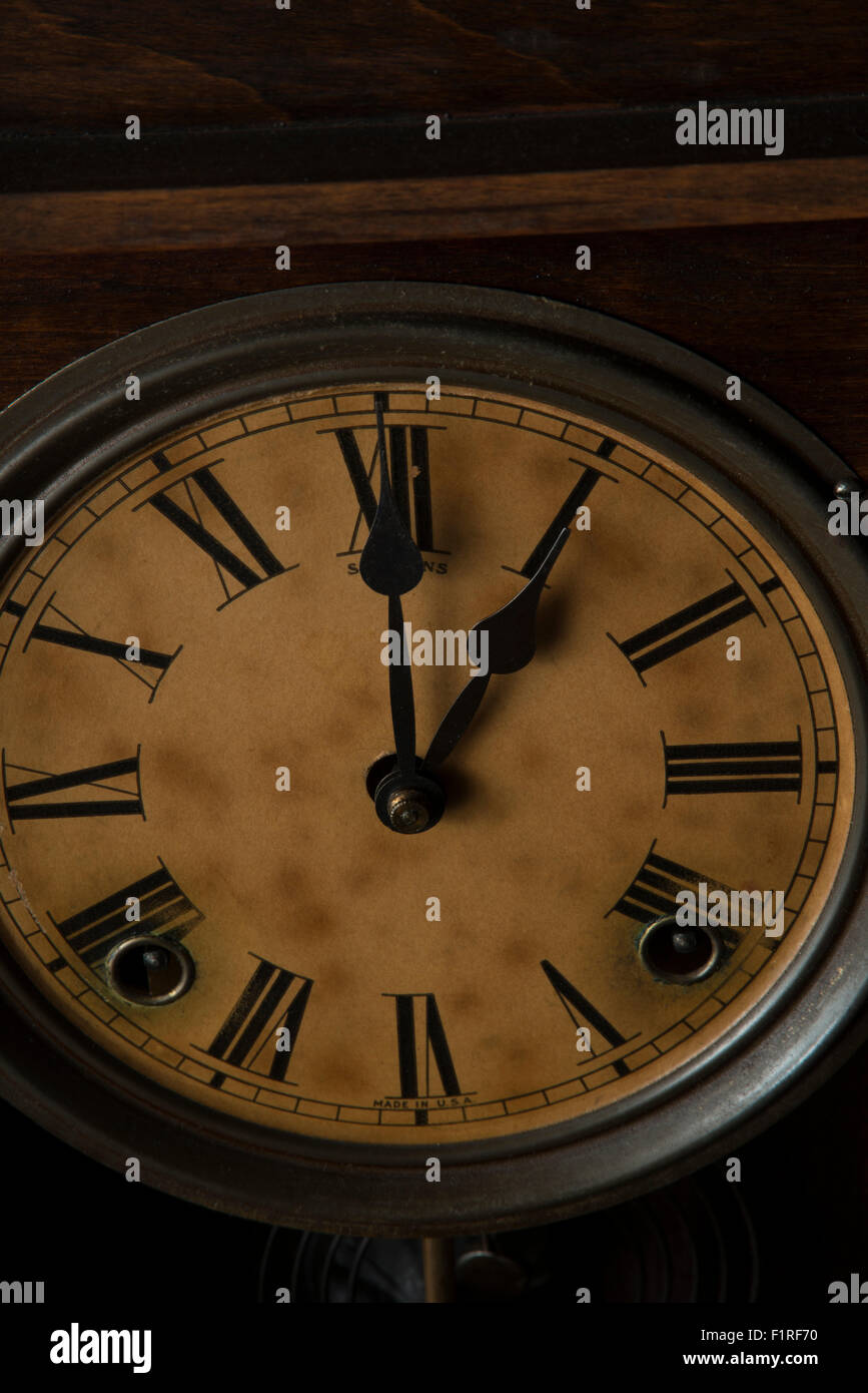 Antique clock showing 1:00 - Stock Image