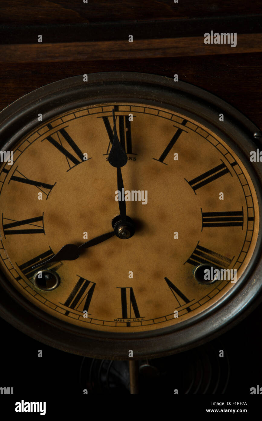 Antique clock showing 8:00 - Stock Image