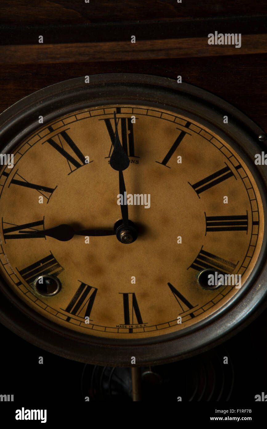 Antique clock showing 9:00 - Stock Image