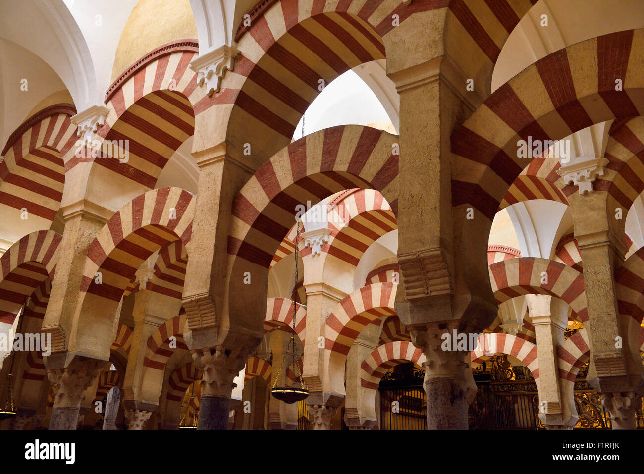 Ceiling with double arches of white stone and red brick at the Prayer Hall of Cordoba Mosque now Our Lady Assumption - Stock Image