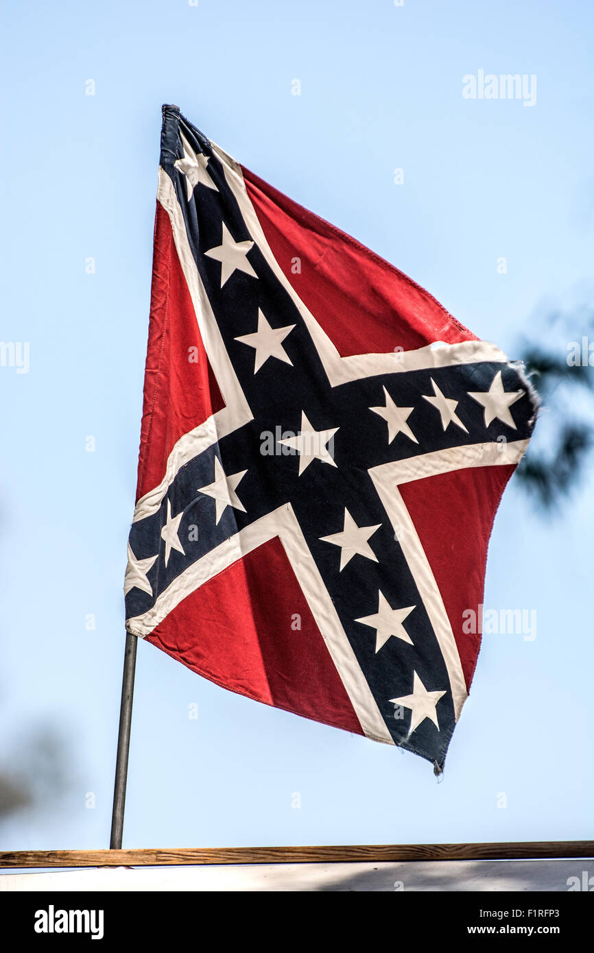 A Confederate flag on top of a building. - Stock Image