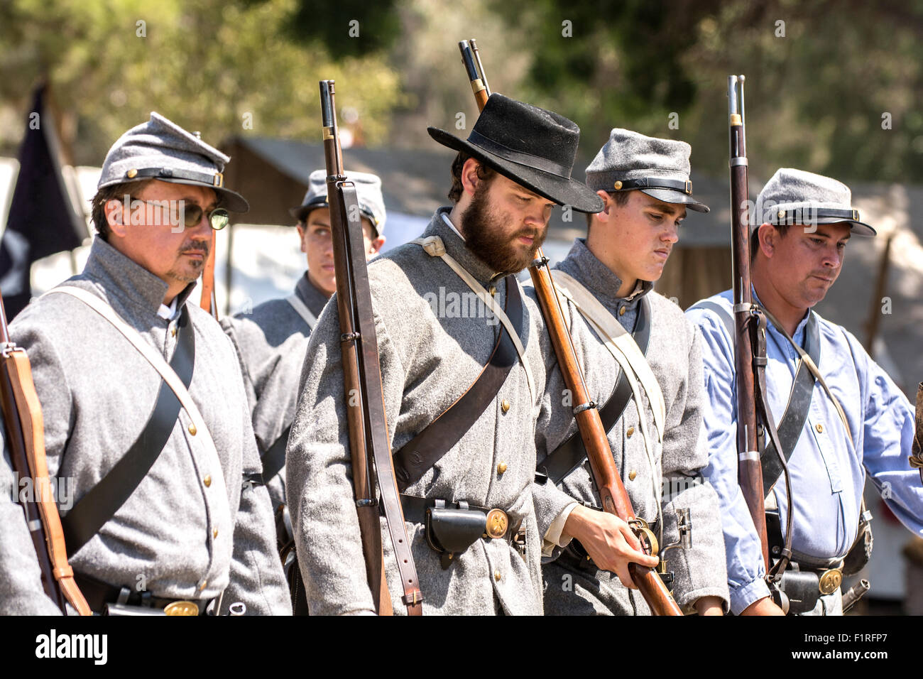 A row of Confederate soldiers standing in formation during a Civil War re-enactment show. - Stock Image