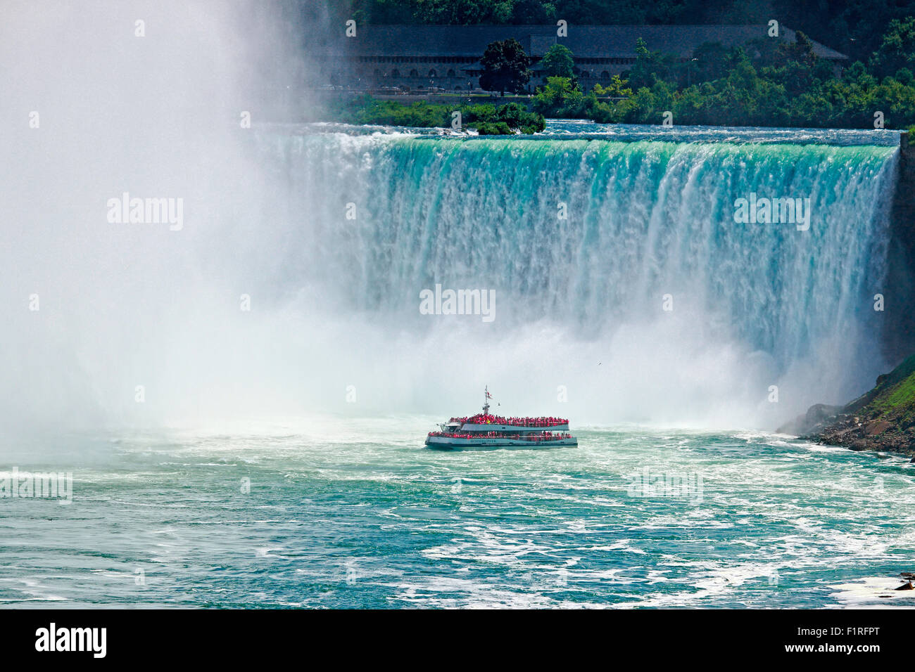 Niagara Falls tour boat Hornblower at the foot of grand Horseshoe Falls - Stock Image