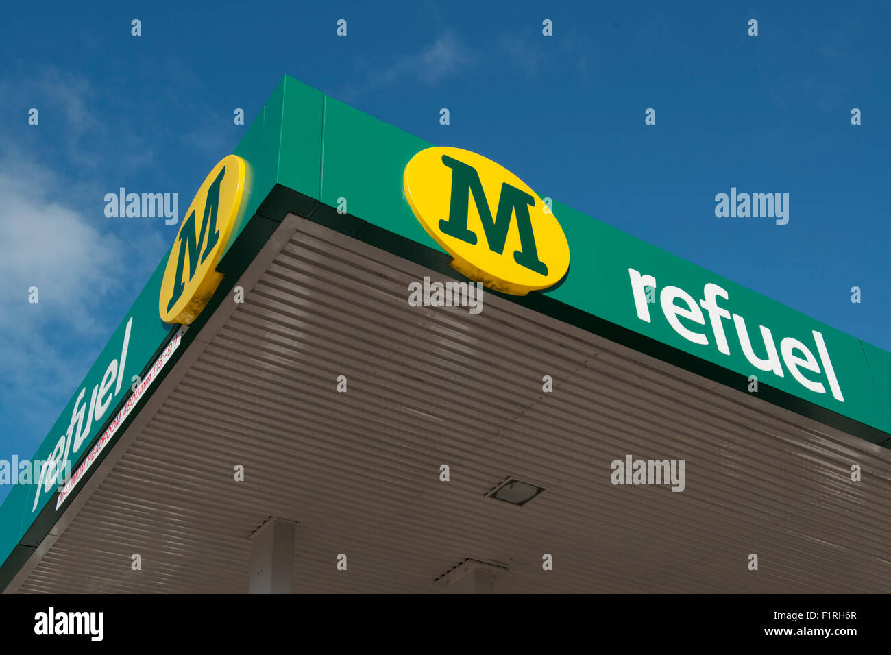 The logo of Morrisons Refuel on a petrol filling station against a blue sky (Editorial use only). - Stock Image