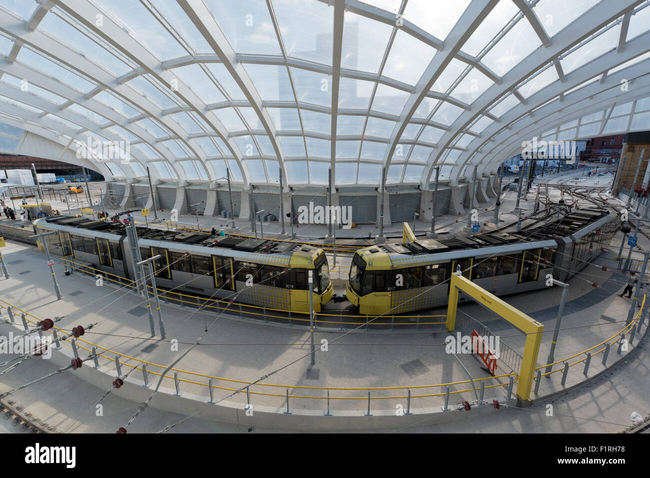 The inside area of the refurbished Victoria Station in Manchester, featuring the Metrolink LRT stop - Stock Image