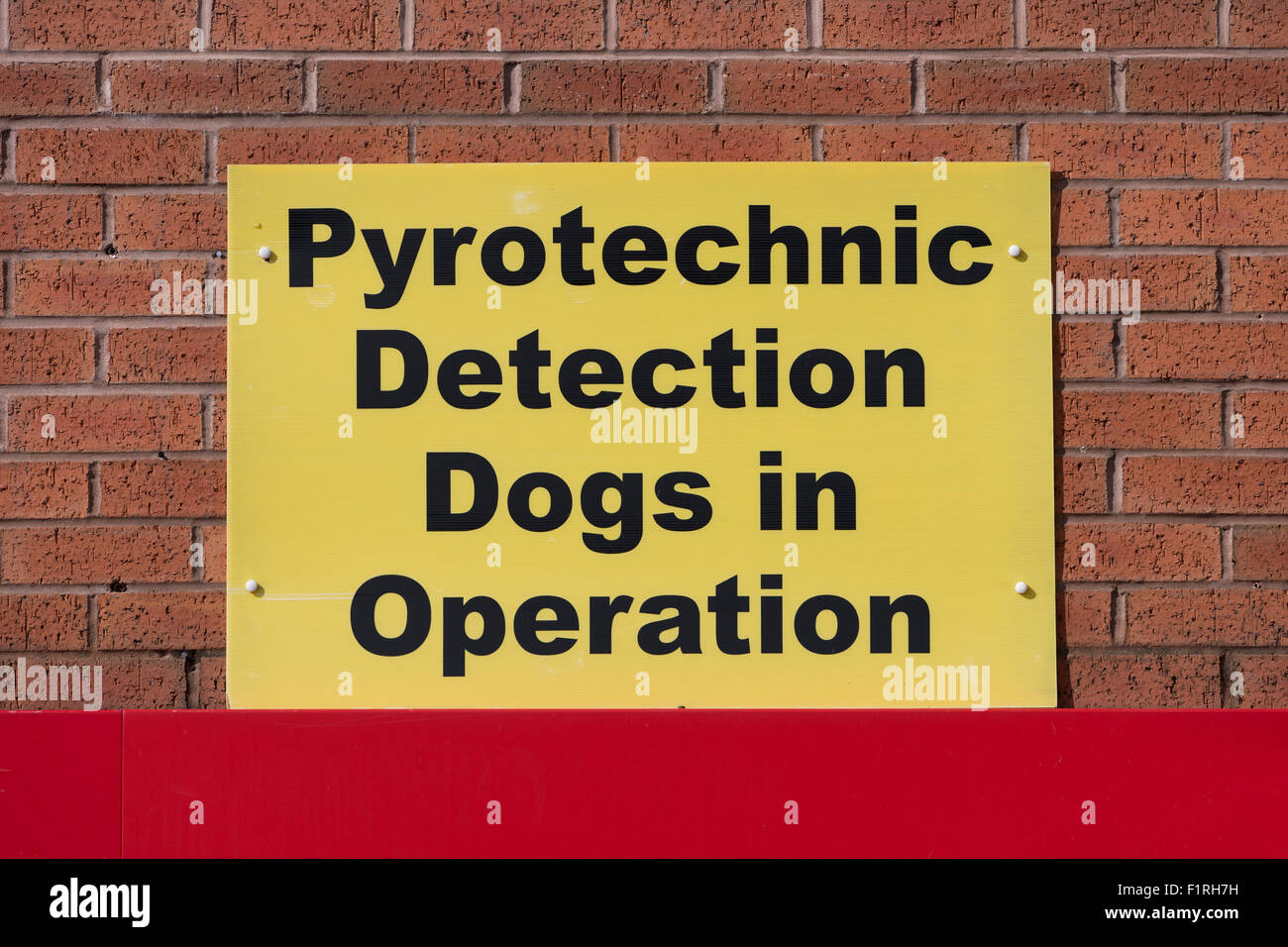 A sign reading Pyrotechnic Detection Dogs in Operation outside the stadium of Manchester United Football Club in - Stock Image