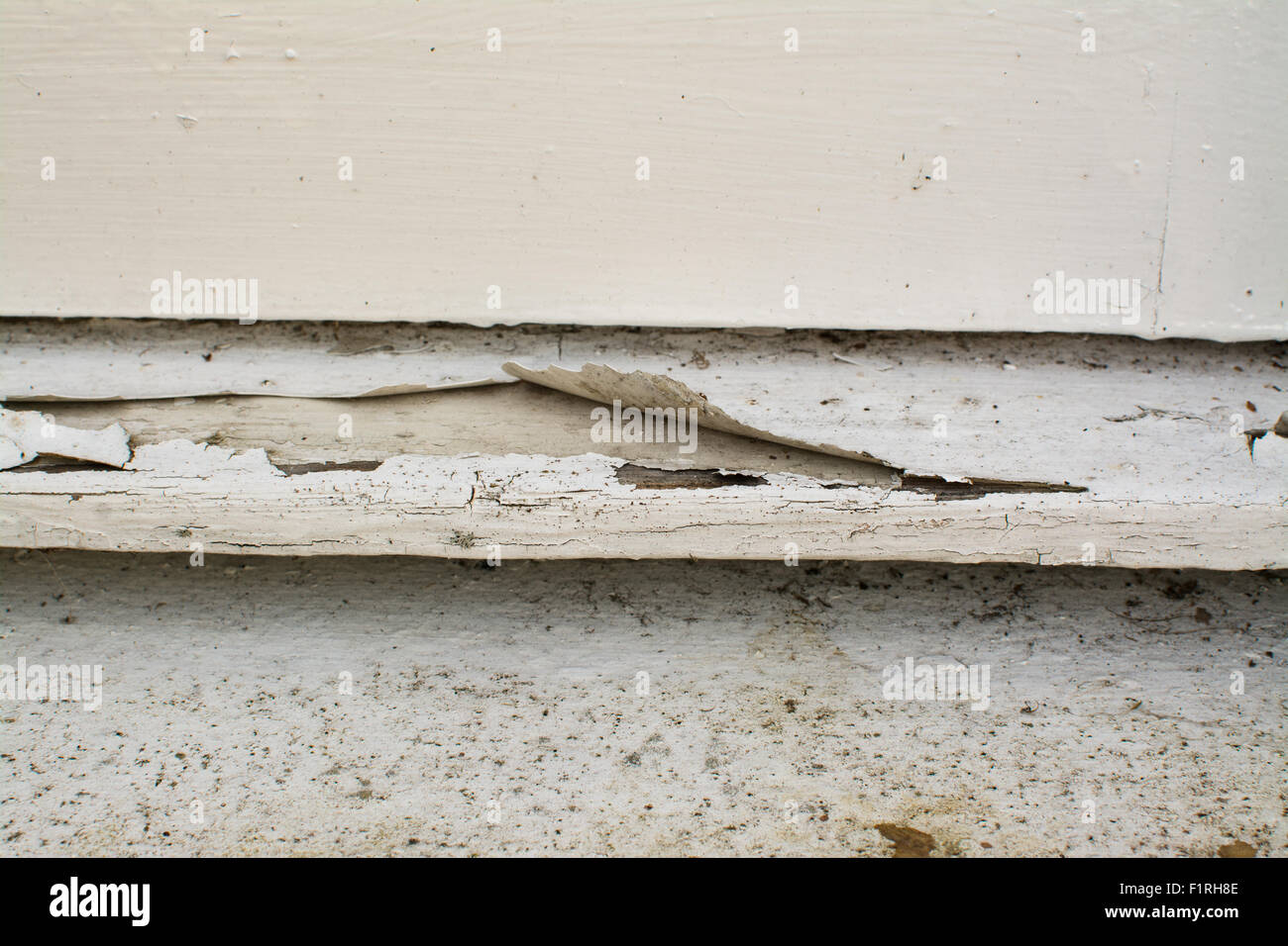 cracked paint peeling off external wooden window sill - Stock Image