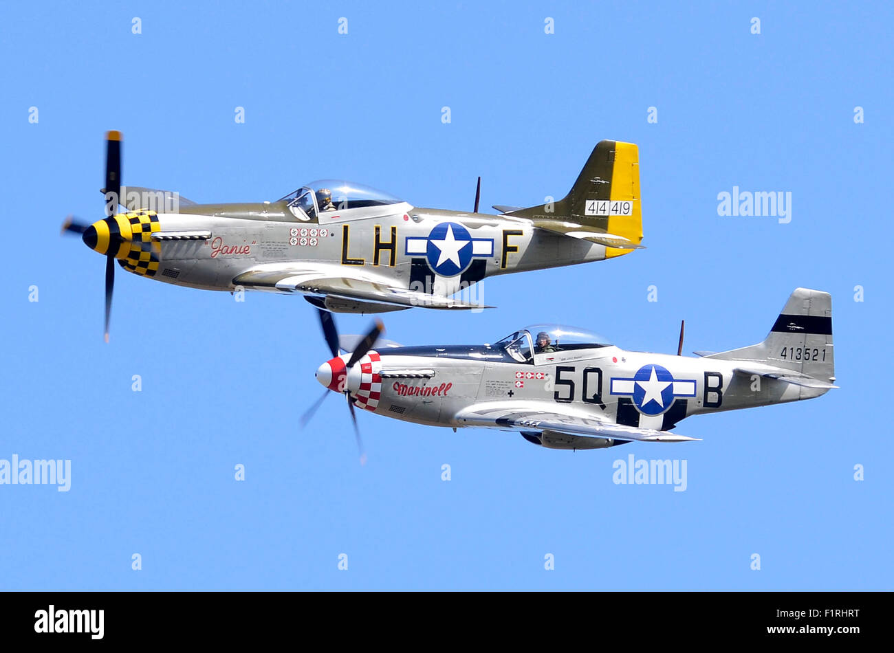 P-51 Mustang pair. These North American P-51D Mustang planes performed a low-level flypast at the Cosby Victory - Stock Image