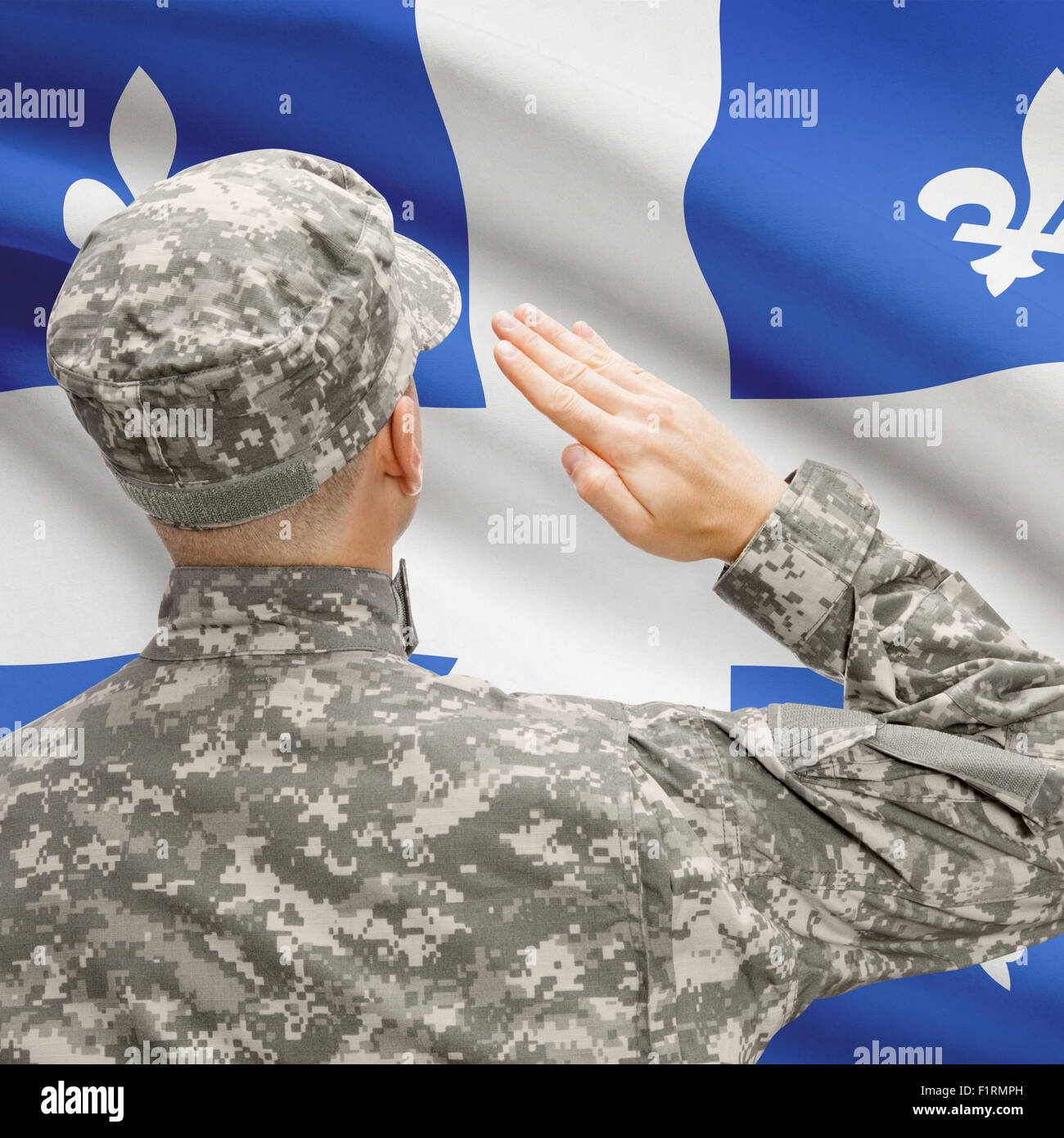 Soldier saluting to Canadial province flag conceptual series - Quebec Stock Photo
