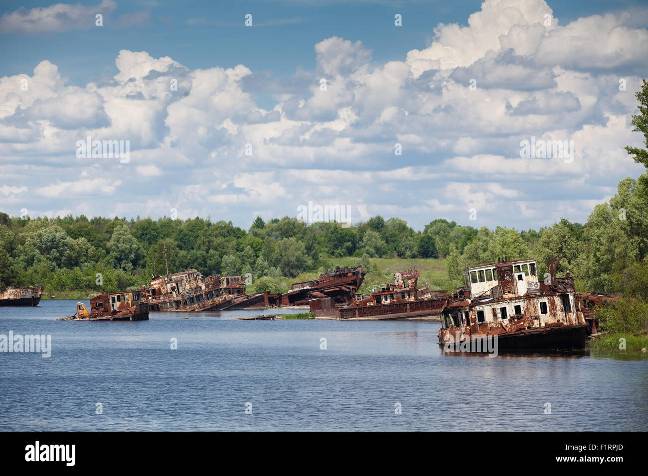 blasted rusty boats - Stock Image