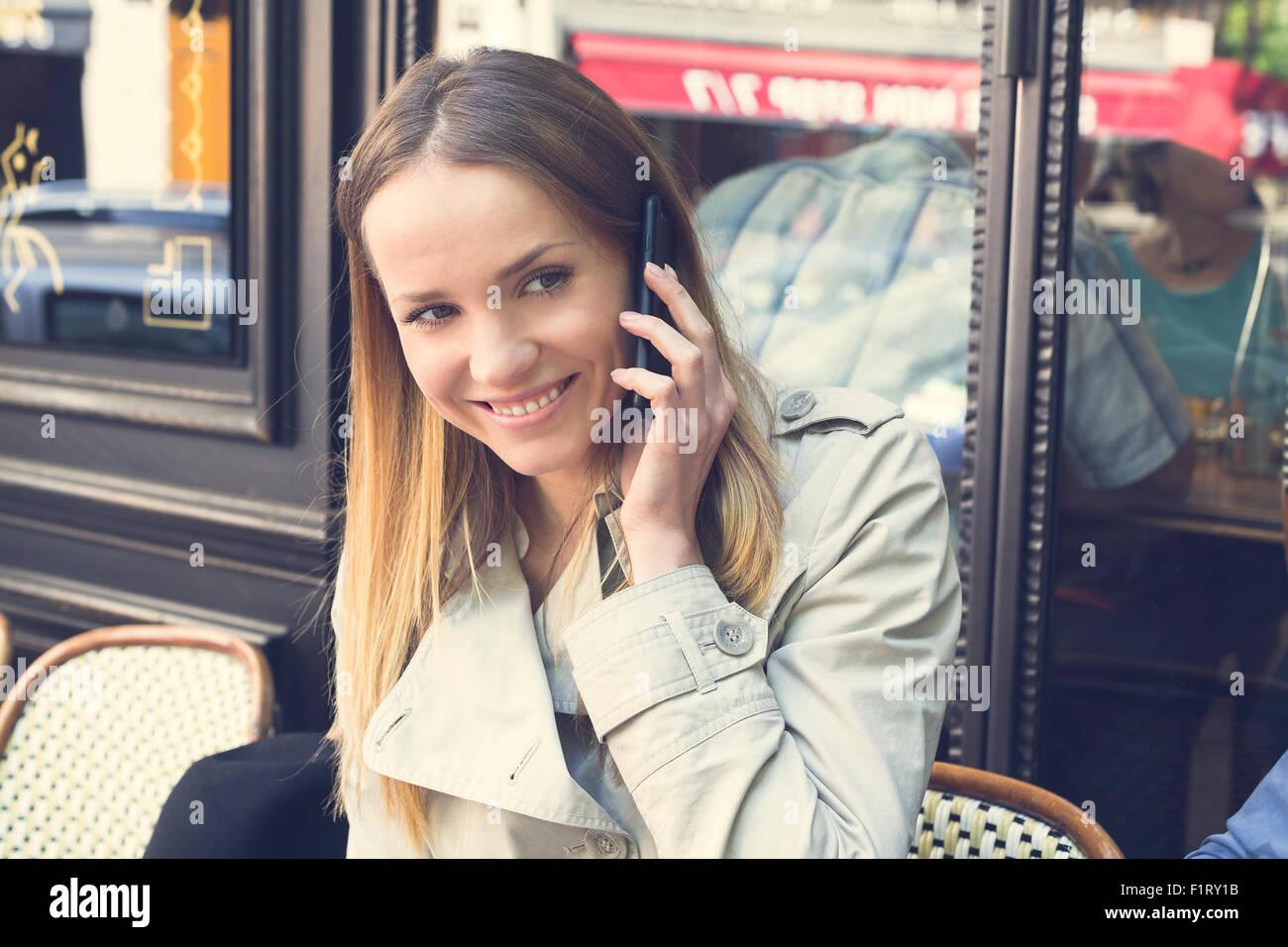 Paris, Woman talking on the phone - Stock Image