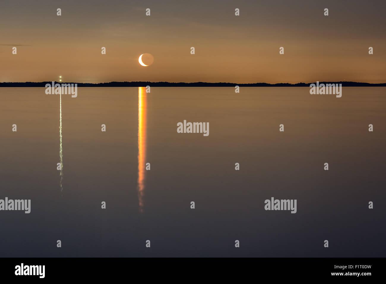 Moon rising seen from Påvskär island, Inkoo, Finland, Europe, EU - Stock Image