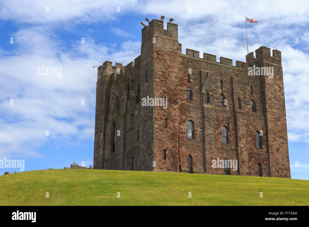 Bamburgh Castle, The Keep, with English flag of St. George, Bamburgh, Northumberland, England, United Kingdom, Europe - Stock Image
