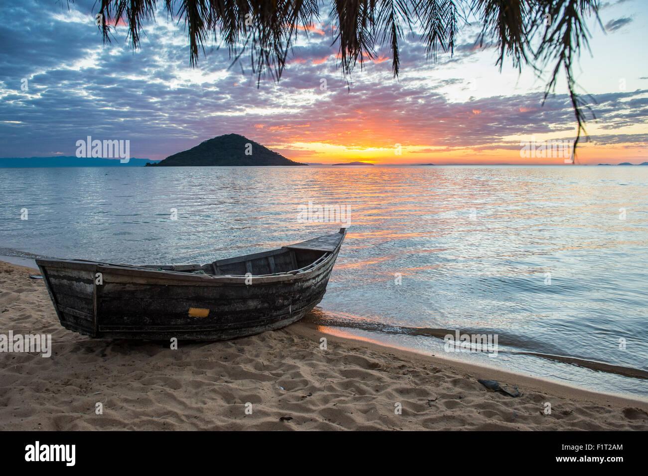 Fishing boat at sunset at Cape Malcear, Lake Malawi, Malawi, Africa - Stock Image